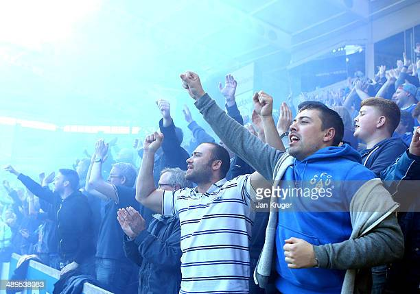 Everton fans celebrate at the final whistle during the Barclays Premier League match between Hull City and Everton at KC Stadium on May 11 2014 in...