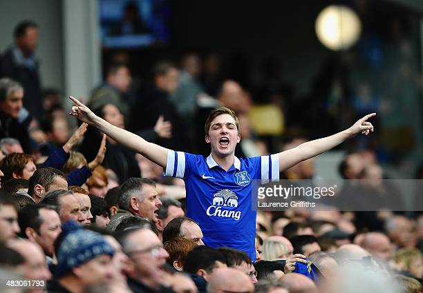 Everton fans celebrate during the Barclays Premier League match between Everton and Arsenal at Goodison Park on April 6 2014 in Liverpool England