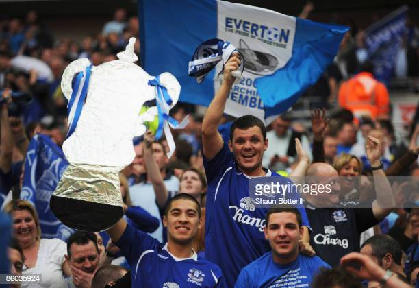 Everton fans celebrate victory in the penalty shoot out during the FA Cup sponsored by EON Semi Final match between Everton and Manchester United at...