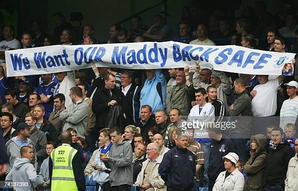 Everton fans hold a banner appealing for the safe return of Madeleine McCann prior to the Barclays Premiership match between Chelsea and Everton at...