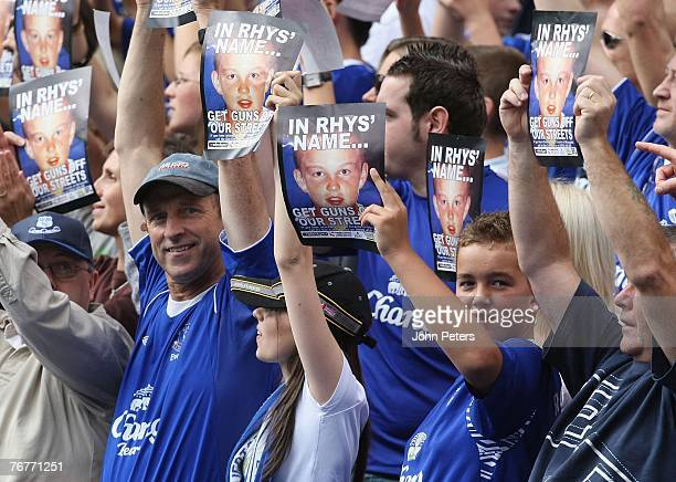 Everton fans hold up posters remembering murdered child Rhys Jones during the Barclays FA Premier League match between Everton and Manchester United...