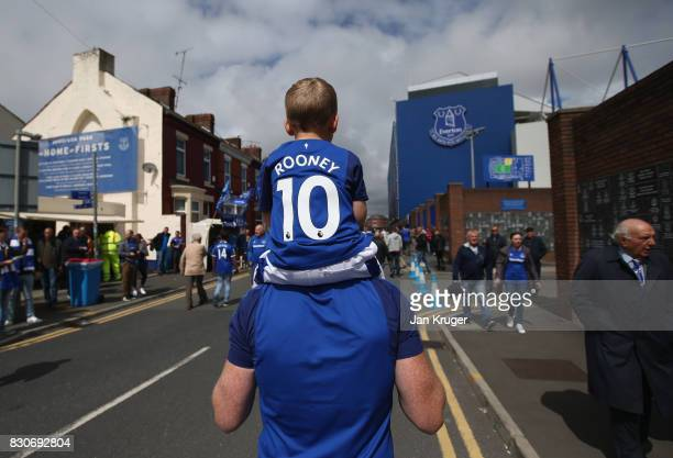 Everton fans make their way to the stadium prior to the Premier League match between Everton and Stoke City at Goodison Park on August 12 2017 in...