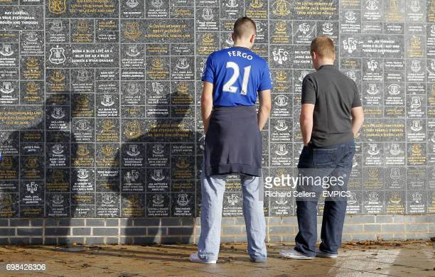 Everton fans read the Dixie Dean Wall of Fame outside Goodison Park