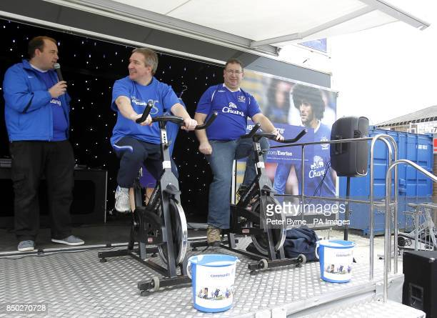 Everton fans ride exercise bikes to raise money on the Everton Roadshow stage before kickoff