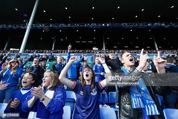 Everton fans show their support during the Barclays Premier League match between Everton and Liverpool at Goodison Park on October 4 2015 in...