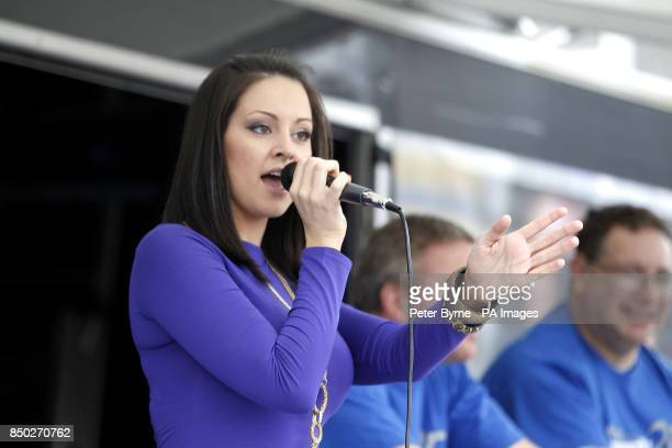 Everton fans use exercise bikes to raise money as singer Jennifer Jewel performs on the Everton Roadshow stage