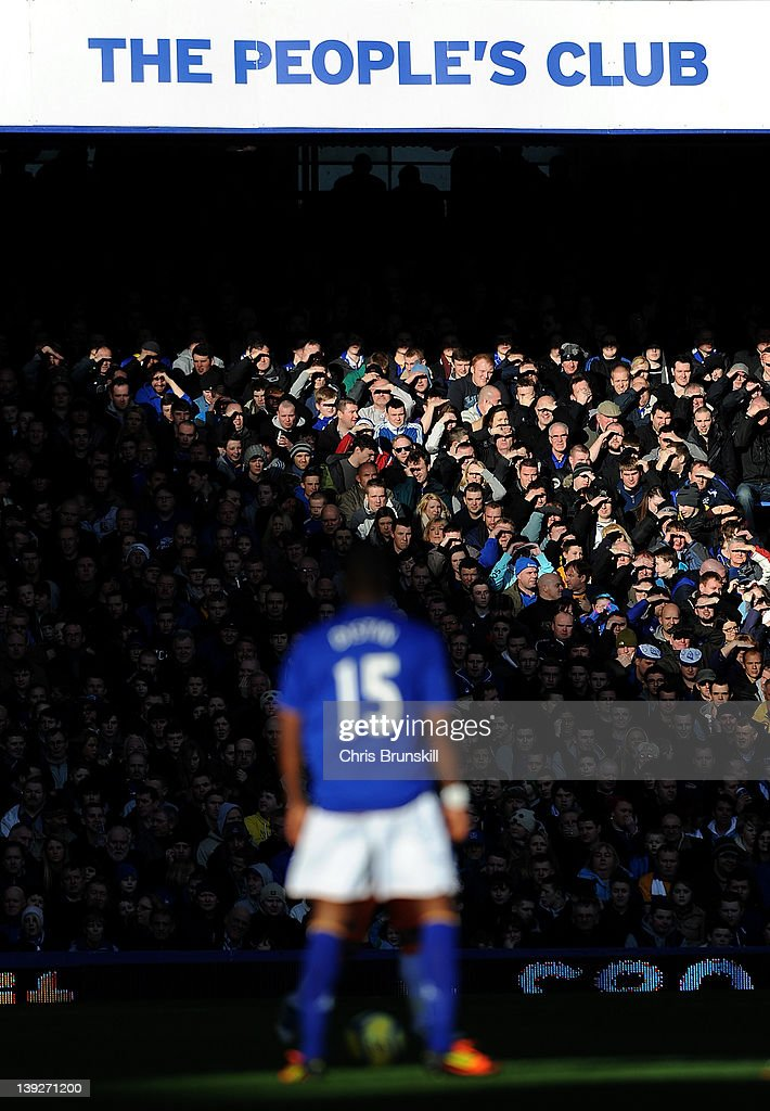 Everton fans watch the action during the FA Cup Fifth Round match between Everton and Blackpool at Goodison Park on February 18, 2012 in Liverpool, England.