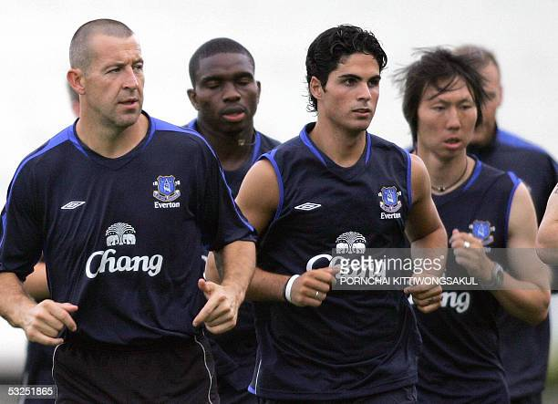 Everton football players warm up during a practice session at the National Stadium in Bangkok 18 July 2005 Everton Bolton and Manchester City are...