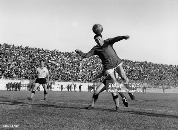 Everton footballer Mike Trebilcock heads the ball goalwards during his team's exhibition match against AEK Athens Athens 20th May 1966