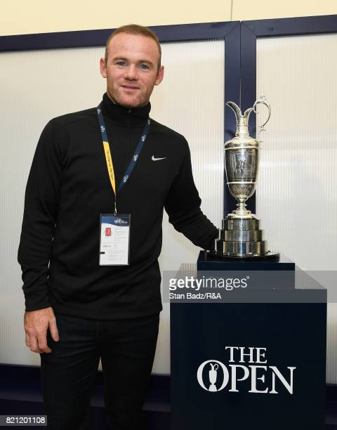 Everton footballer Wayne Rooney poses with the Claret Jug during the final round of the 146th Open Championship at Royal Birkdale on July 23 2017 in...