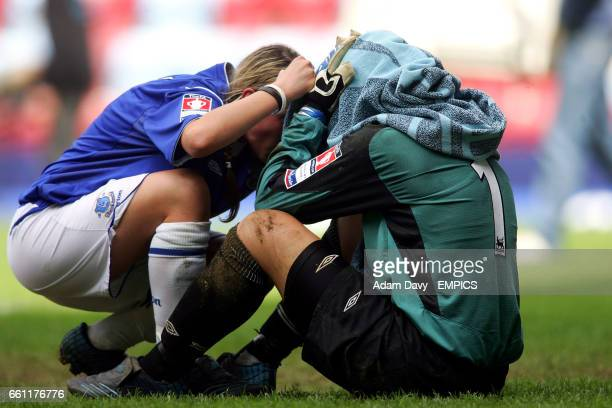 Everton goalkeeper Danielle Hill is comforted by teammate Chantelle Parry
