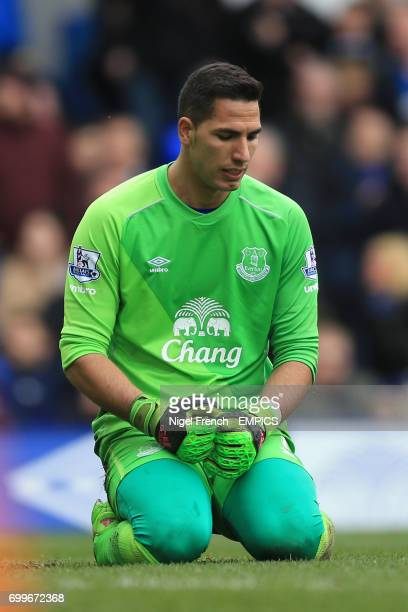Everton goalkeeper Joel Robles appears dejected after letting Alex Iwobi's goal in