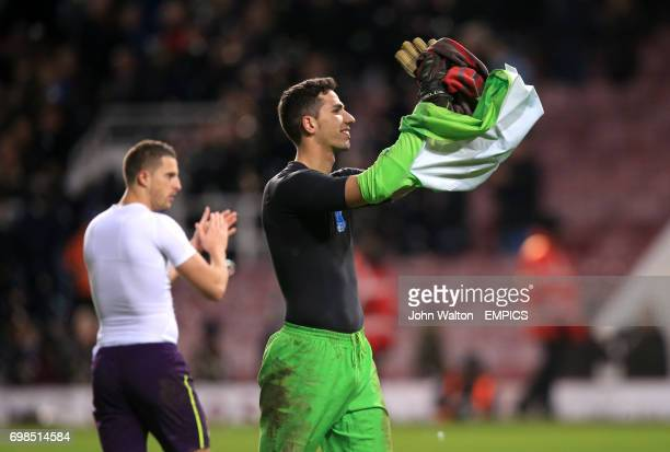 Everton goalkeeper Joel Robles applauds the travelling fans after losing in the penalty shootout
