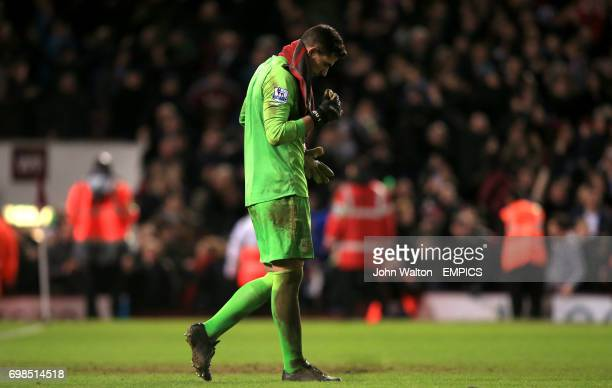 Everton goalkeeper Joel Robles dejected after missing the decisive penalty in the shootout