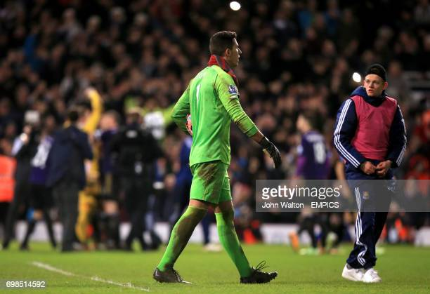 Everton goalkeeper Joel Robles dejected after the shootout after missing the decisive penalty