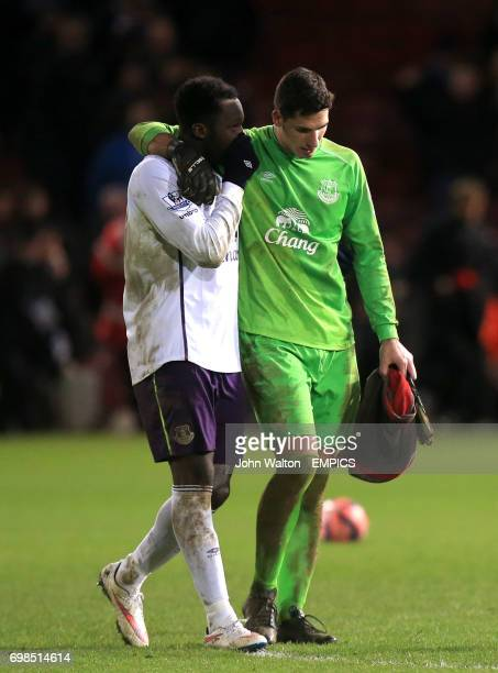 Everton goalkeeper Joel Robles is consoled by teammate Romelu Lukaku after missing the decisive penalty in the shootout