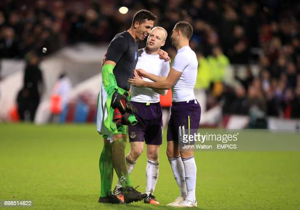 Everton goalkeeper Joel Robles is consoled by teammates Steve Naismith and Kevin Mirallas after missing the decisive penalty in the shootout