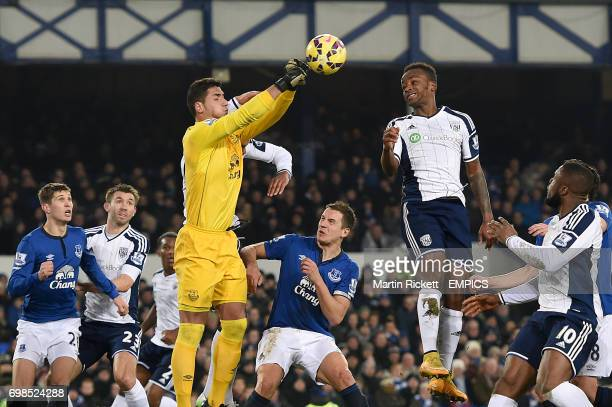 Everton goalkeeper Joel Robles punches clear from West Bromwich Albion's Saido Berahino