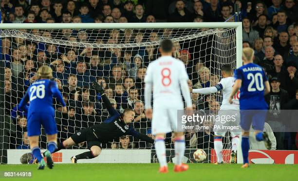 Everton goalkeeper Jordan Pickford fails to save a penalty from Olympique Lyonnais' Nabil Fekir as he scores his side's first goal of the game during...