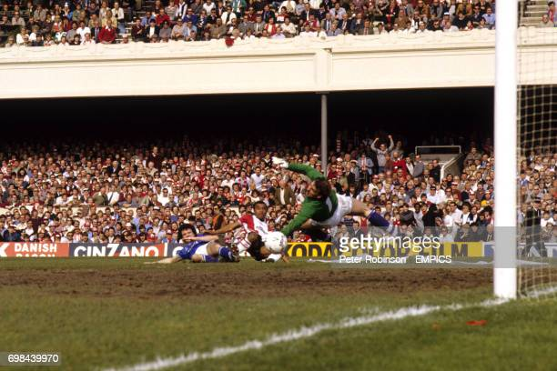 Everton goalkeeper Neville Southall watches as Southampton's Danny Wallace pulls a shot wide under pressure from Everton's Dennis Bailey