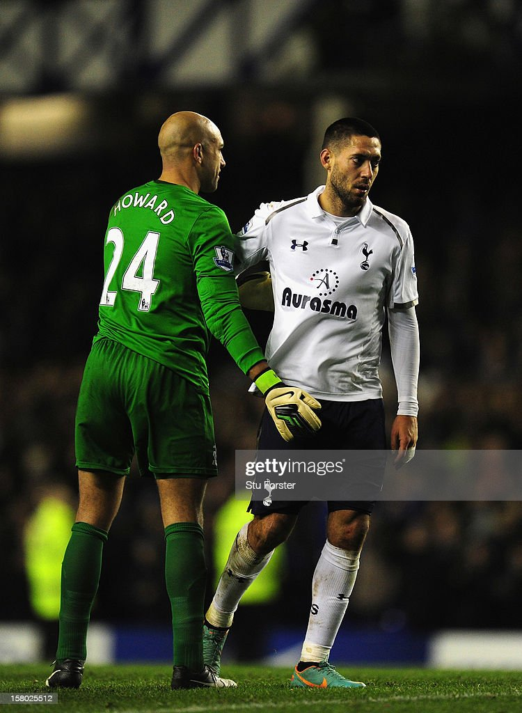 Everton goalkeeper Tim Howard (l) consoles Spurs player Clint Dempsey after during the Barclays Premier game between Everton and Tottenham Hotspur at Goodison Park on December 9, 2012 in Liverpool, England.