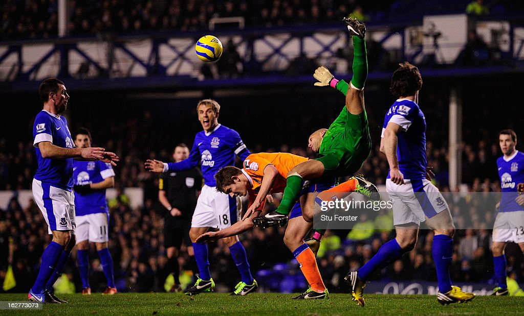 Everton keeper <a gi-track='captionPersonalityLinkClicked' href=/galleries/search?phrase=Tim+Howard+-+Soccer+Player&family=editorial&specificpeople=11515558 ng-click='$event.stopPropagation()'>Tim Howard</a> is challenged by Oldham player James Tarkowski (c) during the FA Cup Fifth Round Replay between Everton and Oldham Athletic at Goodison Park on February 26, 2013 in Liverpool, England.