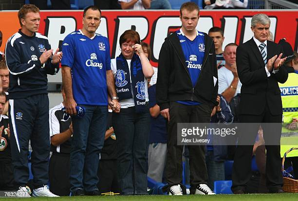 Everton Manager David Moyes and Blackburn Rovers Manager Mark Hughes lead a minutes applause for murdered young Everton fan Rhys Jones as his parents...