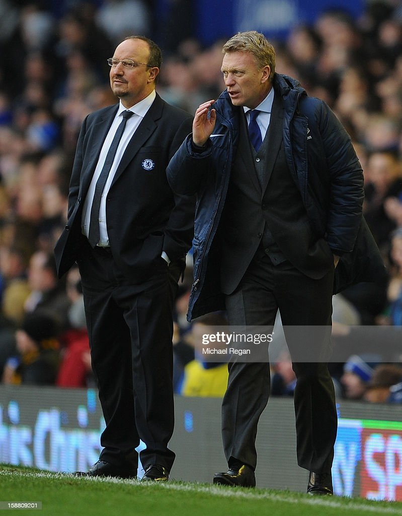 Everton Manager David Moyes and Chelsea Manager Rafael Benitez (L) look on during the Barclays Premier League match between Everton and Chelsea at Goodison Park on December 30, 2012 in Liverpool, England.