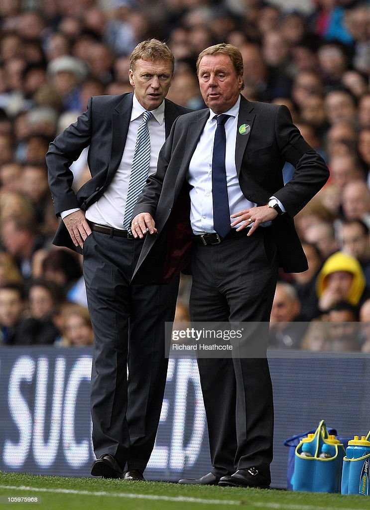 Everton manager <a gi-track='captionPersonalityLinkClicked' href=/galleries/search?phrase=David+Moyes&family=editorial&specificpeople=215482 ng-click='$event.stopPropagation()'>David Moyes</a> and Tottenham manager <a gi-track='captionPersonalityLinkClicked' href=/galleries/search?phrase=Harry+Redknapp&family=editorial&specificpeople=204768 ng-click='$event.stopPropagation()'>Harry Redknapp</a> (R) look on during the Barclays Premier League match between Tottenham Hotspur and Everton at White Hart Lane on October 23, 2010 in London, England.