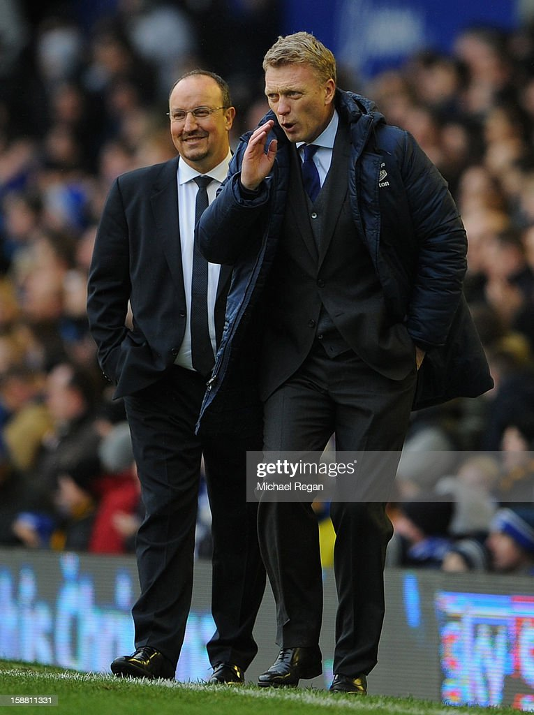 Everton Manager <a gi-track='captionPersonalityLinkClicked' href=/galleries/search?phrase=David+Moyes&family=editorial&specificpeople=215482 ng-click='$event.stopPropagation()'>David Moyes</a> gestures as Chelsea Manager Rafael Benitez looks on during the Barclays Premier League match between Everton and Chelsea at Goodison Park on December 30, 2012 in Liverpool, England.