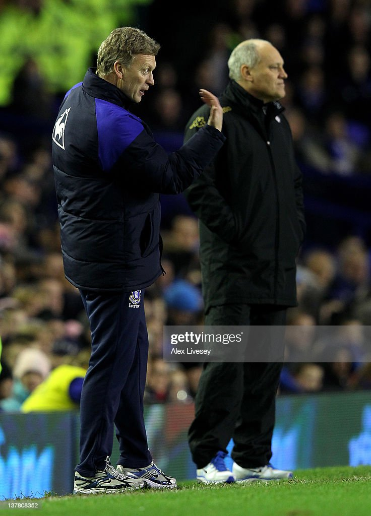 Everton Manager <a gi-track='captionPersonalityLinkClicked' href=/galleries/search?phrase=David+Moyes&family=editorial&specificpeople=215482 ng-click='$event.stopPropagation()'>David Moyes</a> (L) gestures as Fulham Manager <a gi-track='captionPersonalityLinkClicked' href=/galleries/search?phrase=Martin+Jol&family=editorial&specificpeople=215368 ng-click='$event.stopPropagation()'>Martin Jol</a> looks on during the FA Cup Fourth Round match between Everton and Fulham at Goodison Park on January 27, 2012 in Liverpool, England.