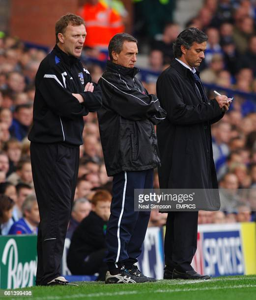 Everton manager David Moyes shouts instructions as Chelsea manager Jose Mourinho takes notes