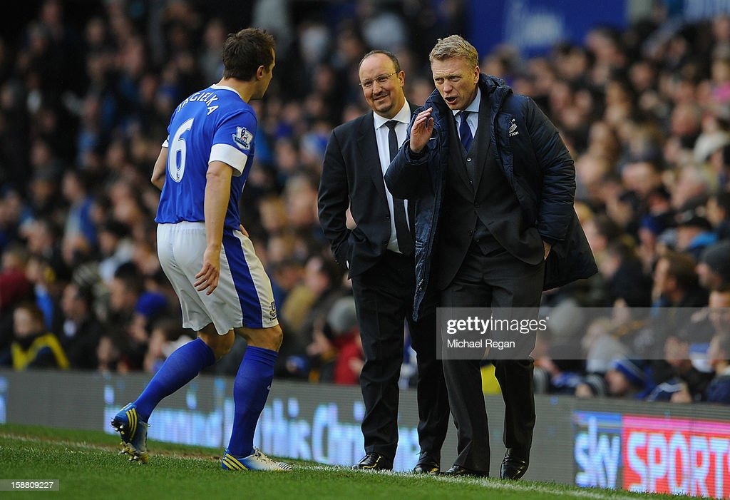 Everton Manager David Moyes speaks to Phil Jagielka as Chelsea Manager Rafael Benitez looks on during the Barclays Premier League match between Everton and Chelsea at Goodison Park on December 30, 2012 in Liverpool, England.