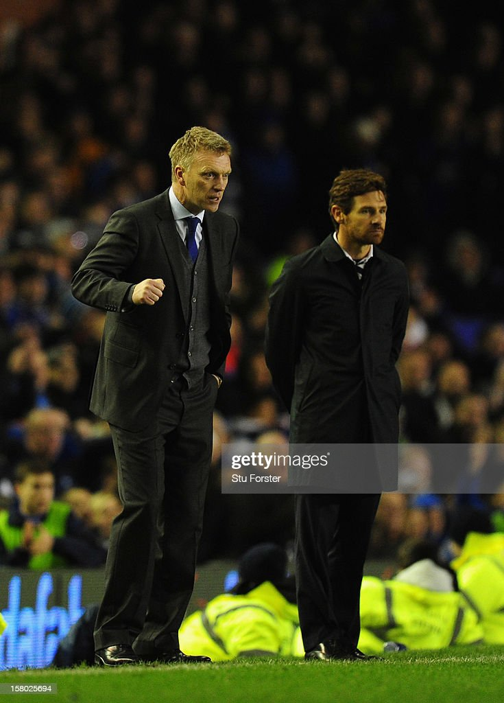 Everton manager David Moyes (l) Spurs manager Andre Villas-Boas look on during the Barclays Premier between Everton and Tottenham Hotspur at Goodison Park on December 9, 2012 in Liverpool, England.