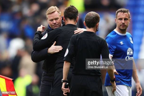 Everton Manager / Head Coach Ronald Koeman embraces Referee Mark Clattenburg at the end of the Premier League match between Everton and Burnley at...