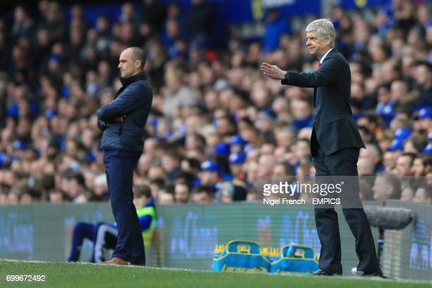 Everton manager Roberto Martinez and Arsenal manager Arsene Wenger stand at the touchline