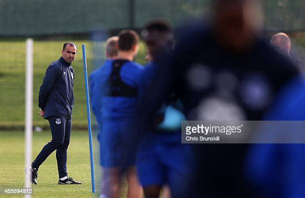 Everton manager Roberto Martinez looks on during a training session at Finch Farm on September 17 2014 in Liverpool England