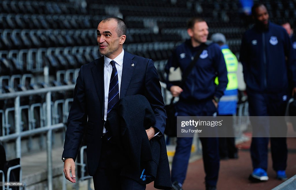 Everton manager Roberto Martinez raises a smile as the team turn up at the stadium before the Barclays Premier League match between Swansea City and Everton at Liberty Stadium on April 11, 2015 in Swansea, Wales.