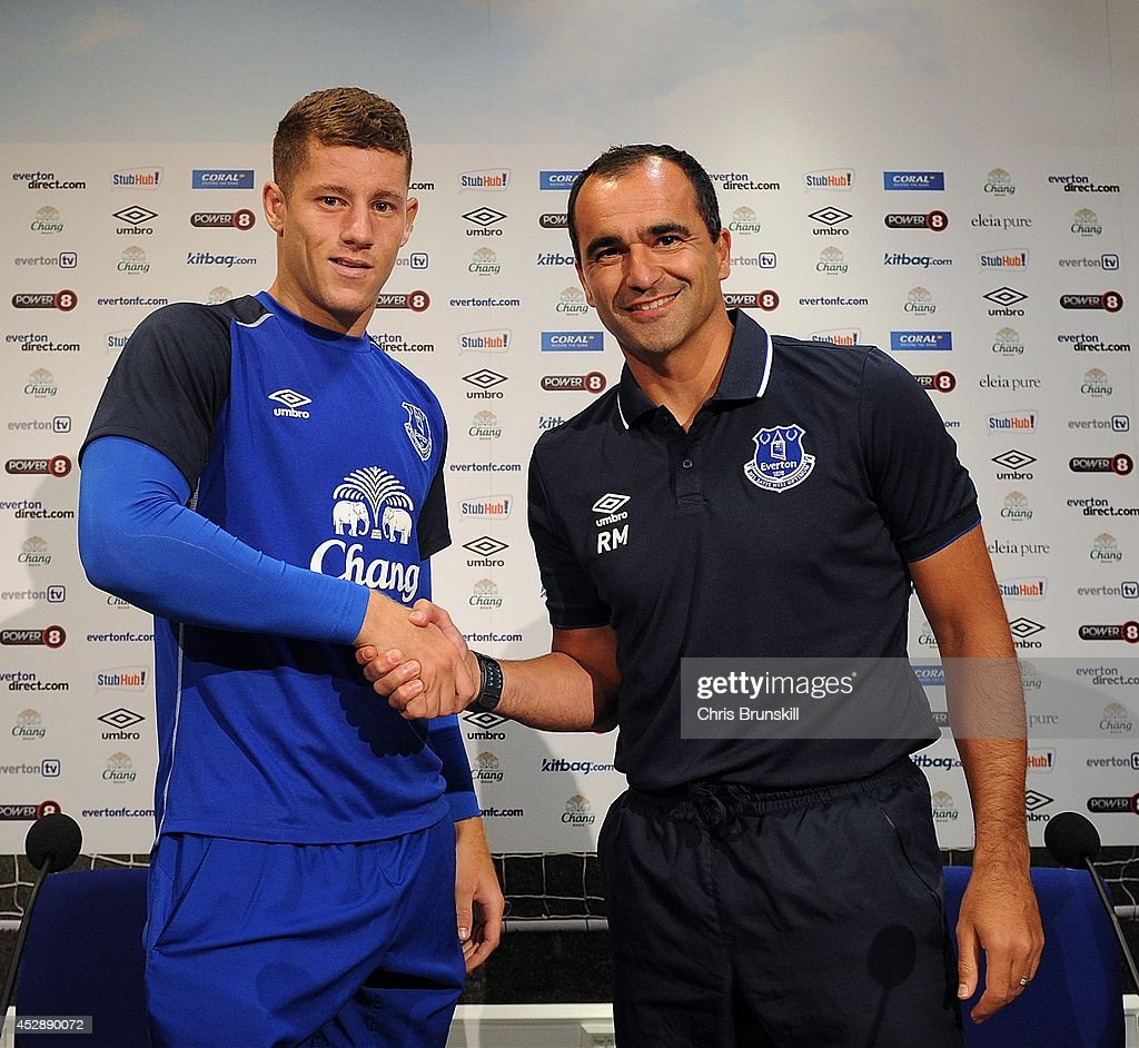Everton manager Roberto Martinez shakes hands with <a gi-track='captionPersonalityLinkClicked' href=/galleries/search?phrase=Ross+Barkley&family=editorial&specificpeople=5806369 ng-click='$event.stopPropagation()'>Ross Barkley</a> during a press conference at Finch Farm on July 29, 2014 in Liverpool, England.