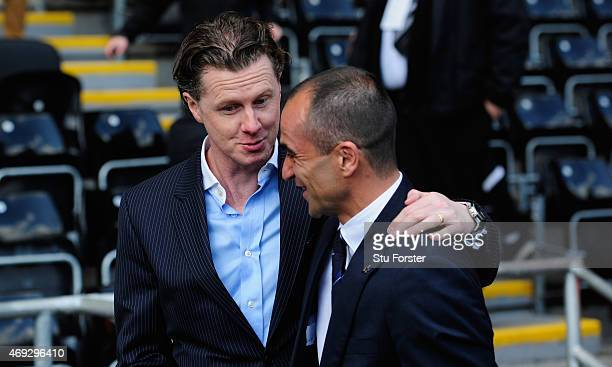 Everton manager Roberto Martinez shares a joke with ex player and TV Pundit Steve McManaman as the team turn up at the stadium before the Barclays...
