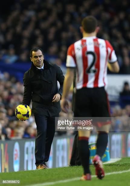 Everton manager Roberto Martinez throws the ball back to Sunderland's Phil Bardsley