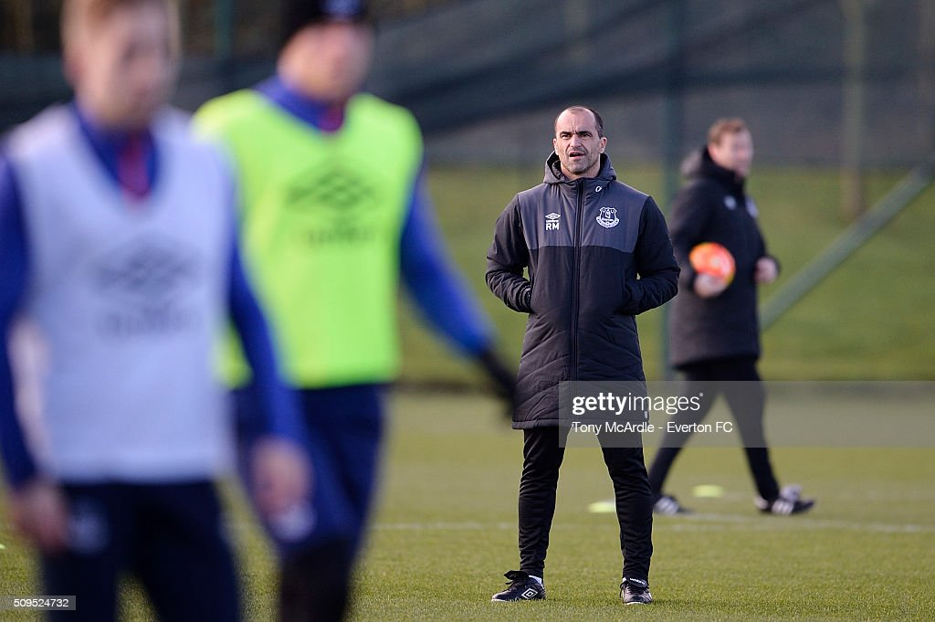 Everton manager Roberto Martinez watches his players during the Everton training session at Finch Farm on February 11, 2016 in Halewood, England.