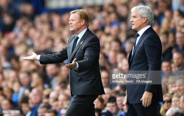 Everton manager Ronald Koeman and Stoke City manager Mark Hughes during the Premier League match at Goodison Park Liverpool