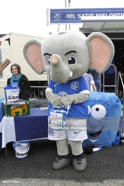 Everton mascot Changy the Elephant holds a fundraising bucket in front of the Everton Roadshow stage