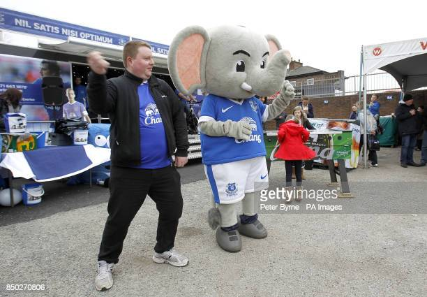 Everton mascot Changy the Elephant performs the gangnam style dance with a fan during the Everton Roadshow