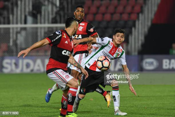 Everton of Brazilian Flamengo fights for the ball with Diego Gutierrez of Chilean Palestino during a Copa Sudamericana 2017 football match at Ilha do...