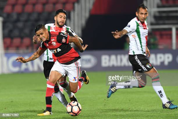 Everton of Brazilian Flamengo vies for the ball with Diego Torres of Chilean Palestino during their Copa Conmebol Sudamericana 2017 second round...