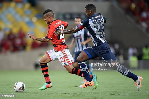 Everton of Flamengo battles for the ball against Gabriel Achilier of Emelec during a match between Flamengo and Emelec as part of Copa Bridgestone...
