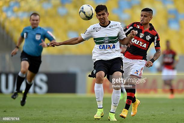 Everton of Flamengo battles for the ball with a Leandro Almeida of Coritiba during a match between Flamengo and Coritiba as part of Brasileirao...