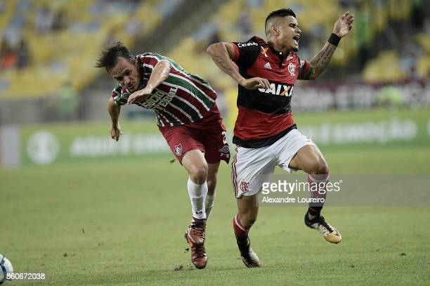 Everton of Flamengo battles for the ball with Lucas of Fluminense during the match between Flamengo and Fluminense as part of Brasileirao Series A...